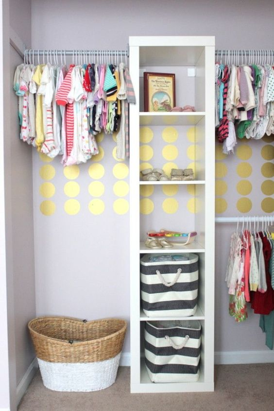 a stylish closet with lots of open storage compartments and clothes hangers is a fun idea with a glam touch