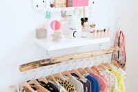 a wooden beam with lots of clothes hangers looks very neat and chic