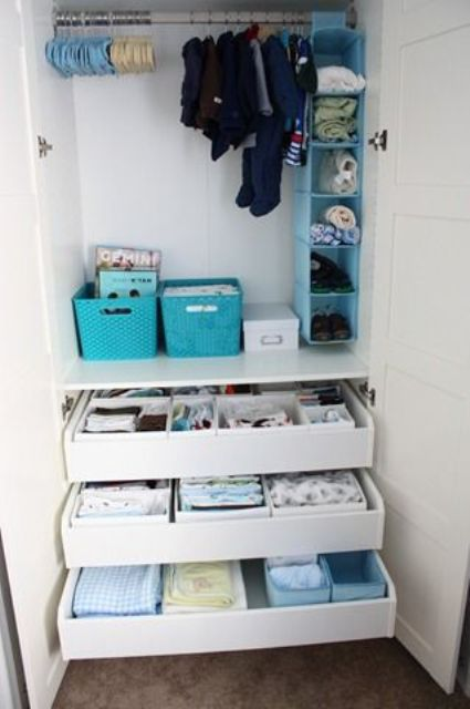 drawers for storage, some boxes and an open storage unit in various bright colors to organize kids' clothes