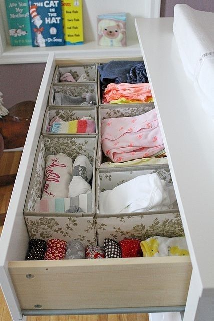 organize a drawer with fabric boxes to store the clothes and other stuff with comfort