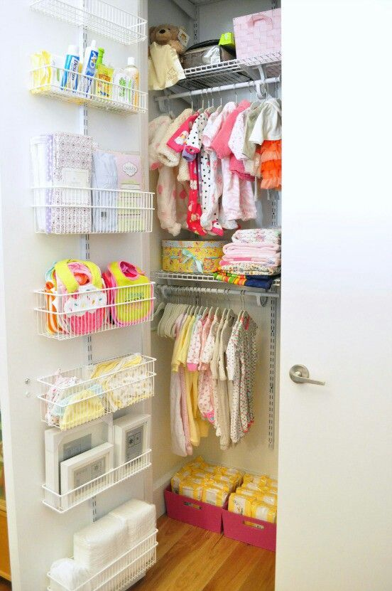 a well-organized closet with wire baskets on the door, boxes and clothes hangers