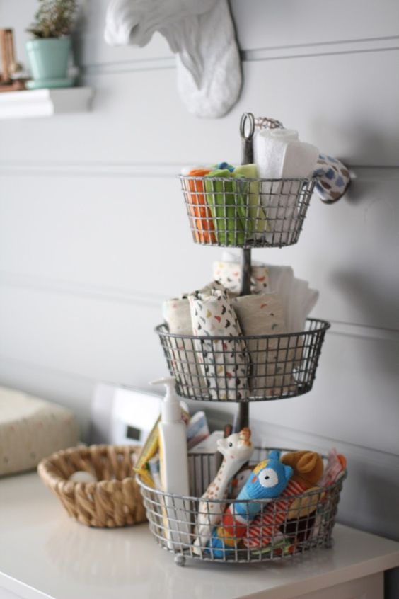 a stand with wire baskets is a nice idea for storage, place it on your changing table