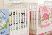 a neutral shared nursery with neutral furniture, shutters and colorful printed bedding to accent the spaces