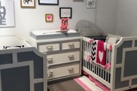 a bright modern nursery in grey and various neutrals, with geometric patterns, colorful linens and a gallery wall