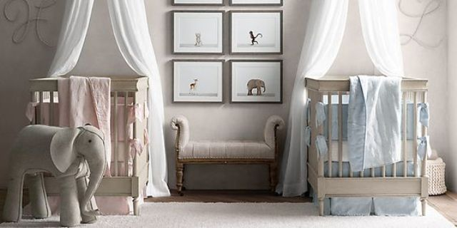 an all-neutral shared nursery with neutral furniture, artworks and toys and blue and pink linens to accent each baby's space