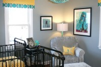 a bright shared nursery with grey walls, touches of turquoise and yellow, black forged cribs and printed linens