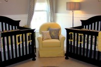 an elegant rustic nursery in white and dove grey, with black furniture, grey polka dot curtains and a yellow chair plus yellow accents all over