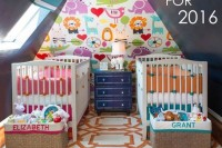 a colorful shared nursery with chalkboard walls, a colorful accent wall, bright bedding and lots of toys
