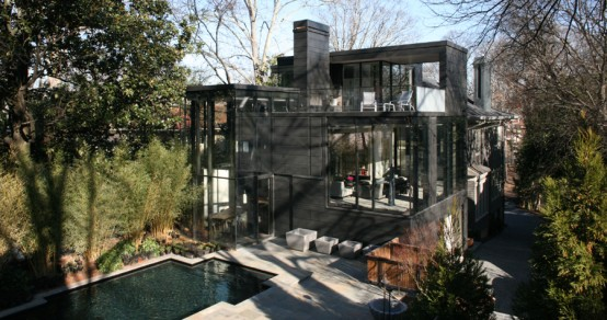 Dark Glass House With City Skyline Views