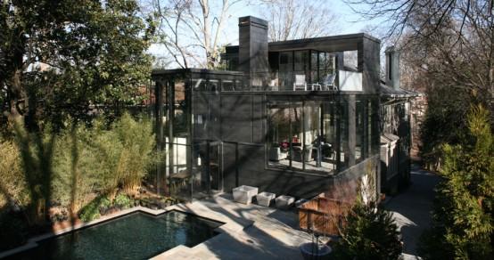 Contemporary Dark Glass House with City Skyline Views
