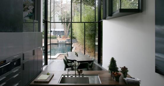 Dark Glass House With City Skyline Views