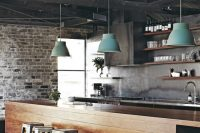 dark rustic ceiling and lots of other lements make this kitchen design truly industrial