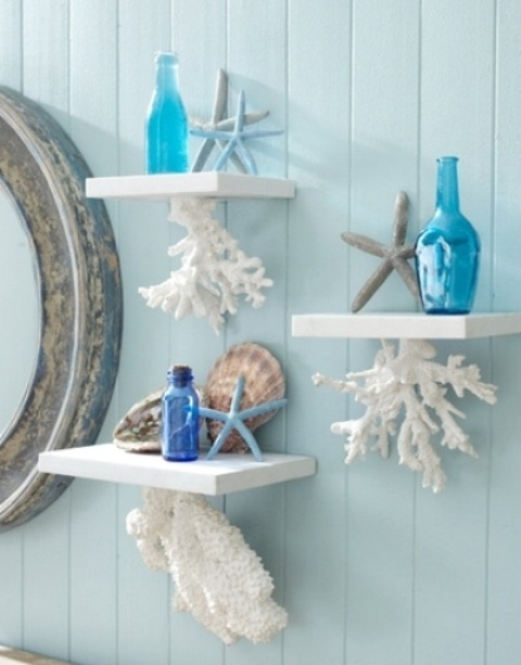 bathroom shelves with corals attached to the bottom of each piece is a lovely idea for a seaside or coastal bathroom