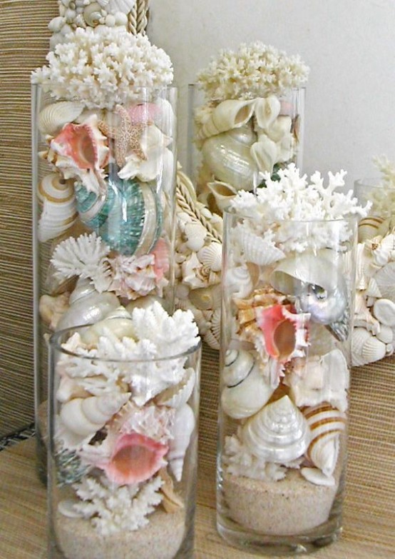 jars and tall vases filled with corals and seashells is a lovely idea for a coastal home, and they can be placed anywhere
