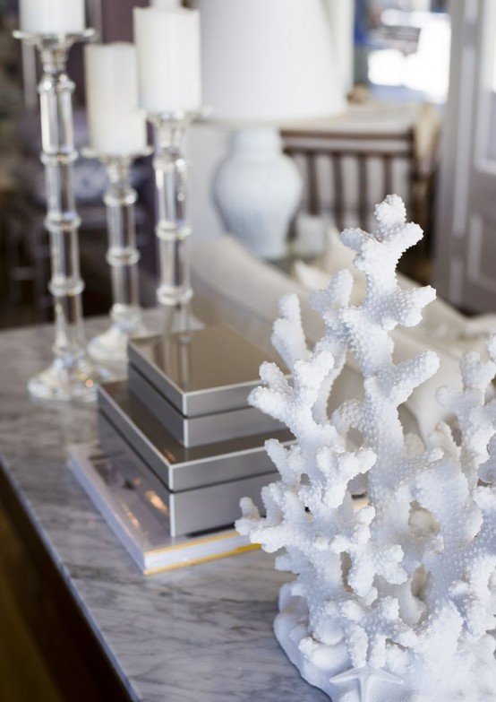 display corals on your console table to give a seaside feel to your living room or entryway and enjoy the look