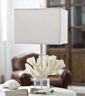 a lovely seaside table lamp with a coral at the base and a neutral lampshade is a lovely idea to rock for a coastal space
