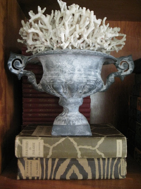 a vintage stone urn with corals is a beautiful vintage-inspired decoration for both indoors and outdoors