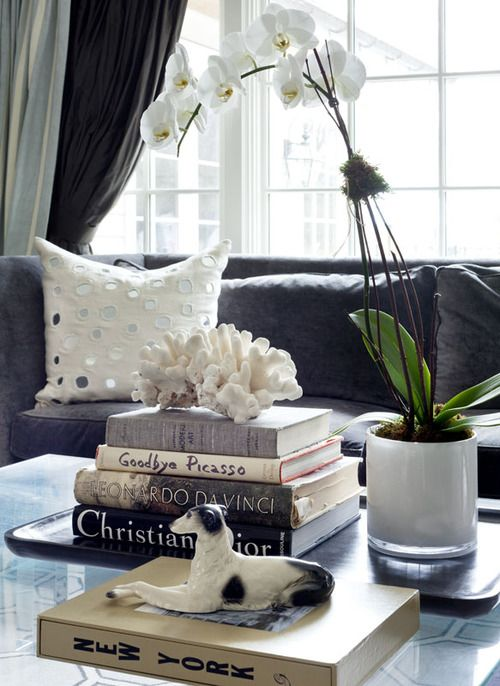corals on top of stack of books is a lovely idea for a refined and cool coastal interior, and is easy to compose