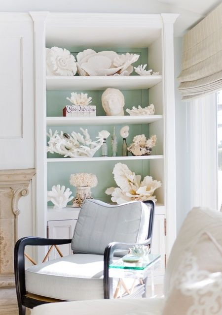 an outdoor storage unit filled with seashells and corals is a gorgeous solution that will scream seaside and seas