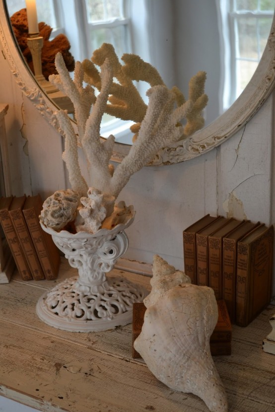 a vintage urn with sea foam and corals is a very creative and cool idea to decorate a seaside home