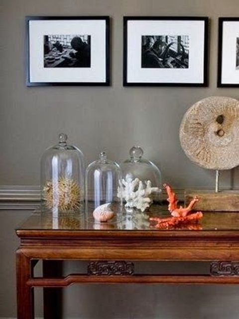 seaside home decor made of corals placed in cloches is a lovely idea for a seaside or coastal wedding
