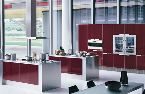 a contemporary deep red, white and stainless steel kitchen with sleek panels and a glazed wall is a very chic space