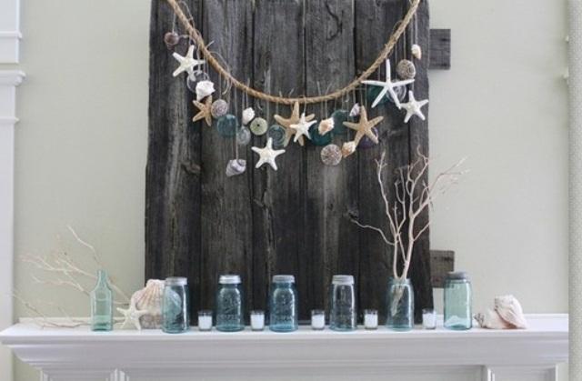 seashells, starfish, driftwood, blue jars, candles, a driftwood plank and a rope with seashells, starfish and blue floats