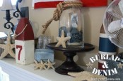 a nautical beach mantel with starfish, a jar with pebbles, rope, color block and striped bottles and candle holders