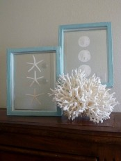 corals and seashells and starfish artworks on the mantel make it feel beach-like and cool