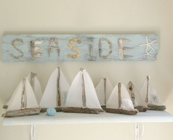 simple DIY boats and a blue beach sign over the mantel, some seashells and starfish for a beach mantel