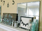 starfish and seashells, blue bottles, signs and a burlap garland will make your mantel look beachy and relaxed