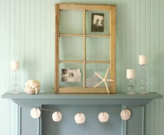 a seashell garland, candles, starfish and seashells, a rope ball will make your mantel look very beach-like