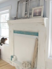 starfish, frames, a beachy artwork, corals and blue and white candles in the non-working fireplace