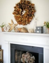 seashells, corals, starfish, some blooms and a dried leaf wreath over the mantel to make it look beachy yet fall-infused