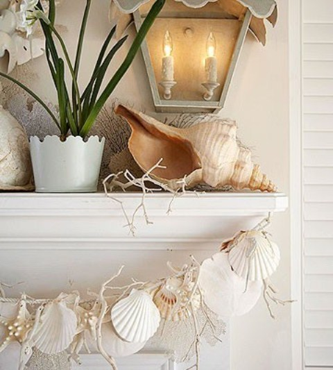 a giant seashell, corals and a garland of seashells and starfish will make your mantel very beach-like and holiday-inspired