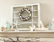 starfish, rope balls, aqua bottles and star plates, a wreath with seashells and starfish for making your mantel beach-like