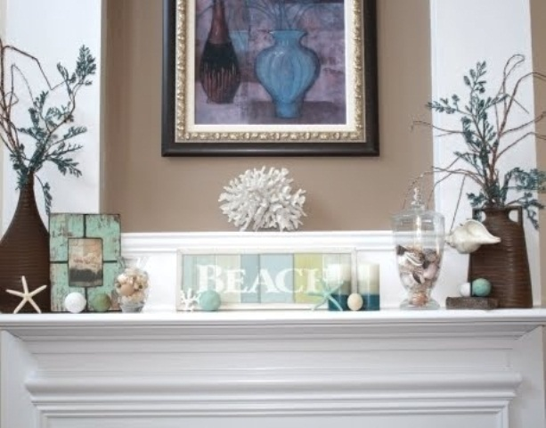 a beachy mantel with striped candles, corals, seashells and starfish, jars with seashells is very cool