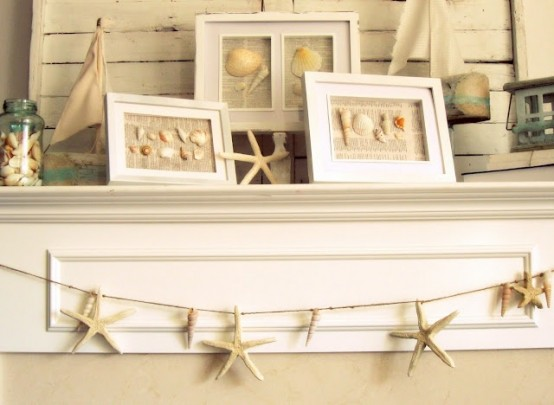 a neutral beach mantel with seashell artworks, starfish and a jar with seashells, a garland of starfish for a vacation-inspired mantel