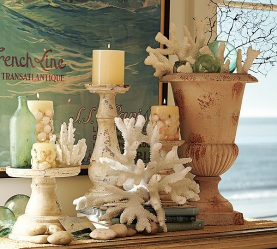 a coral, candle in candleholders, touches of aqua and blue, a vintage urn for a shabby chic beach mantel