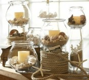 jars with beach sand, starfish, seashells and candles, rope covered jars and rope will make the mantel look beach-like and cozy