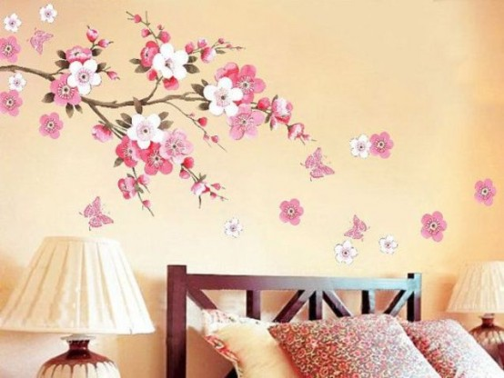 cherry blossom decals accenting the sleeping space is a cool idea for spring and will bring a tender touch to the space