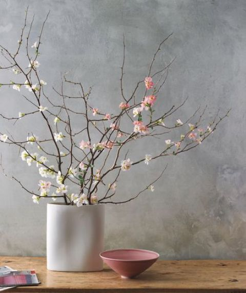 natural cherry blossom in a neutral vase make up a cool spring centerpiece or a tender decoration