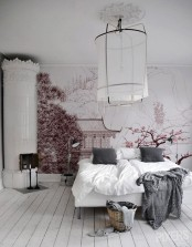 delicate cherry blossom on the wall makes the room look chic, romantic and spring-like