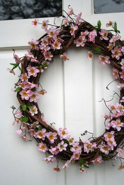 a vine and cherry blossom wreath will make your front door look very spring-like and very chic