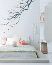 use wall decals on the wall over the bed to make your bedroom feel more like spring