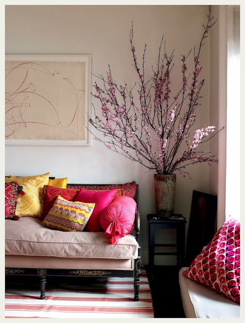 a large tin vase with blooming branches is a nice decoration idea for any home, it's very romantic