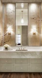 cherry blossom decor on neutral tiles is a chic idea for a modern bathroom