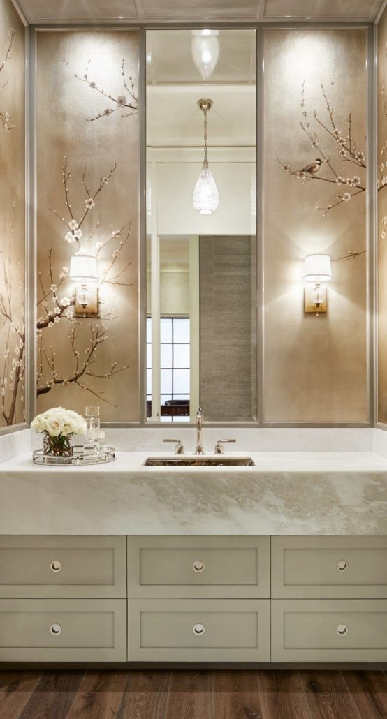 cherry blossom decor on neutral tiles is a chic idea for a modern bathroom
