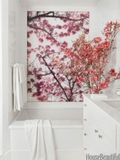 faux pink blooming branches and cherry blossom on the wall to make the bathroom spring-y