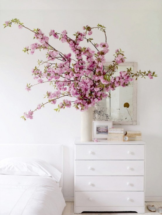 super lush pink blooming branches in a white vase is a cool decoration and centerpiece for spring